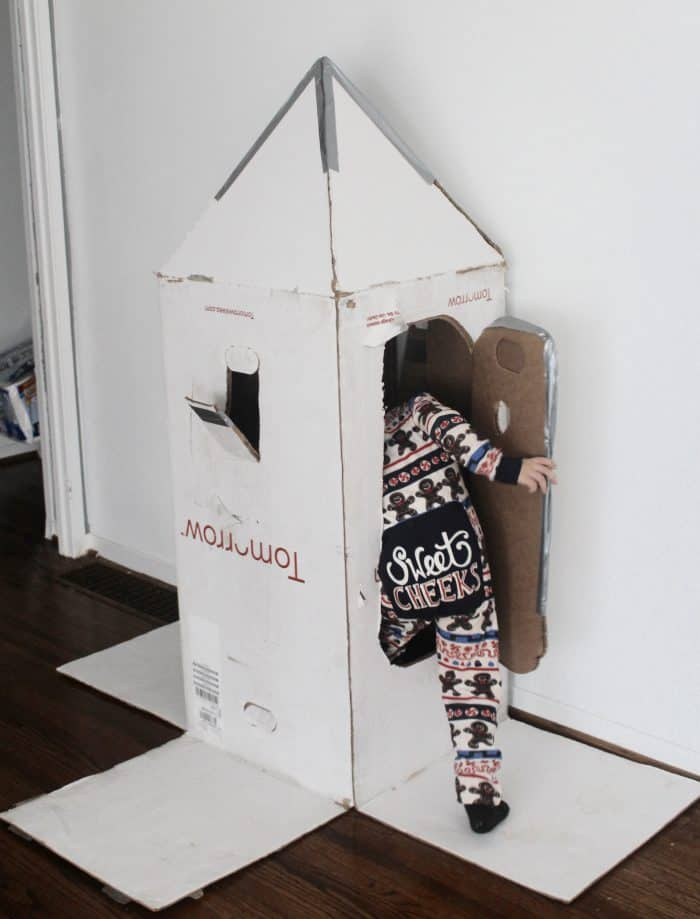 cardboard boxes used as toys or indoor toddler activities