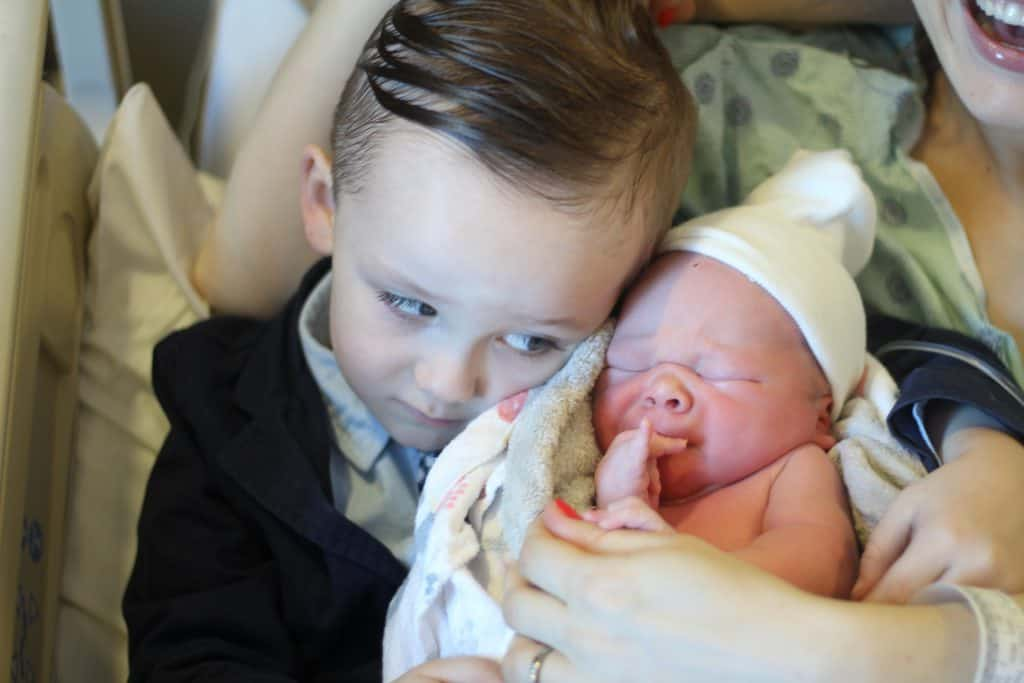 Meeting baby brother. Precious moment!
