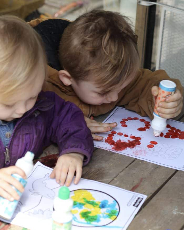 Easy crafts for toddlers being used like these doadot markers outside on a picnic table
