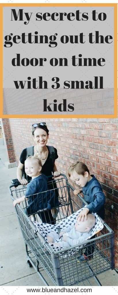 My secrets to getting out the door on time with three kids under four. Photo of a mom with three kids in a shopping cart next to a brick wall.