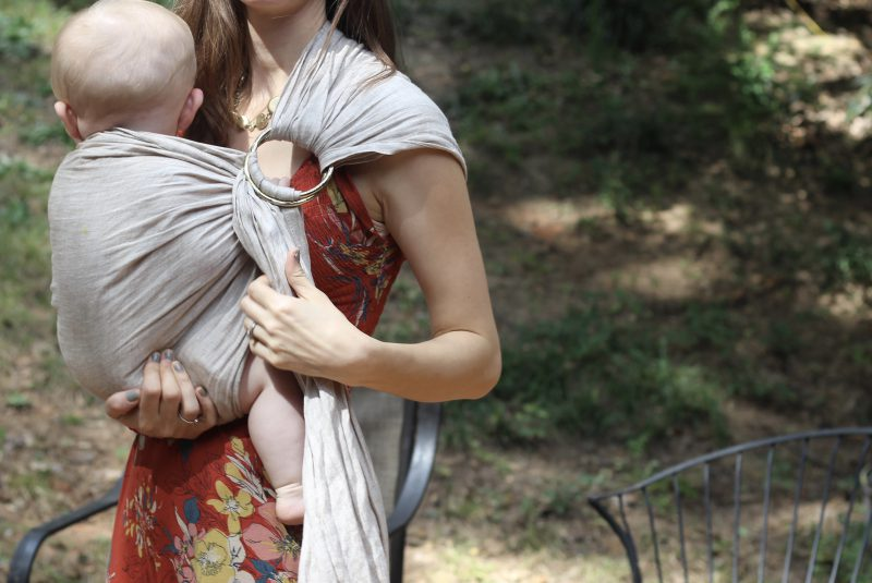 Lillebaby ring sling review in golden harvest, holding a 6 month old baby