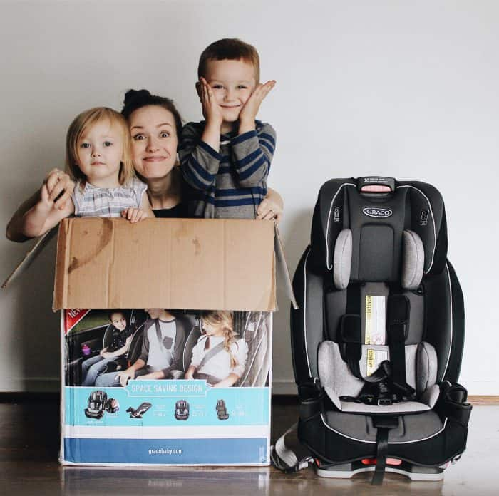 Mom And Her Two Kids Inside Of A Box Smiling Which Is Next To