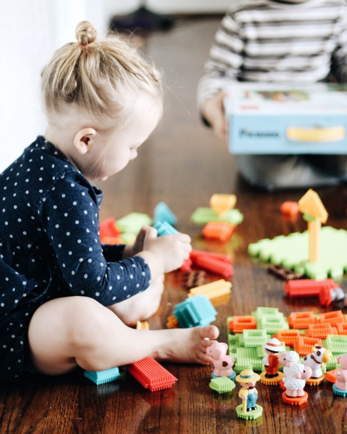 Picasso Tiles 100 piece Bristle Shape Blocks as an indoor activity for a toddler girl
