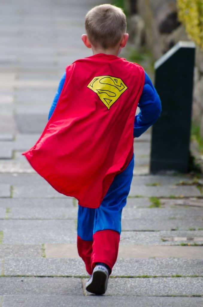 boy wearing a superman costume.