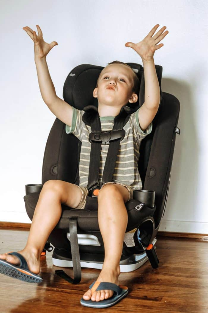 5 year old boy making space ship noises while buckled into a black Maxi-Cosi Magellan 5-in-1 Convertible Car Seat