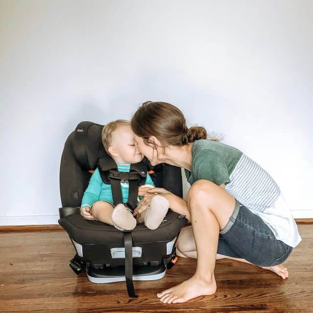 A mom touching noses with her baby while he is strapped into a black Maxi-Cosi Magellan 5-in-1 Convertible Car Seat