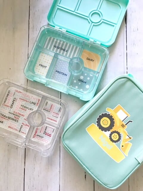 seafoam blue bento box from stuck on you with cooler bag showing a yellow tractor and extra plastic tray