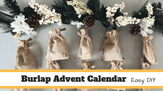 diy burlap bag advent calendar made with burlap bags, clothespins, a branch, and pine or fake pine.
