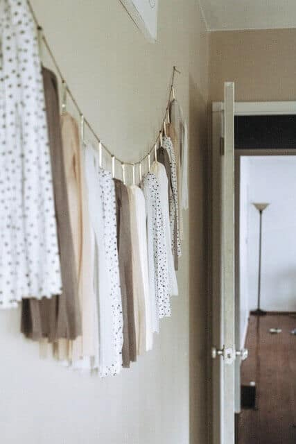 neutral tissue garland room decor hanging on a wall