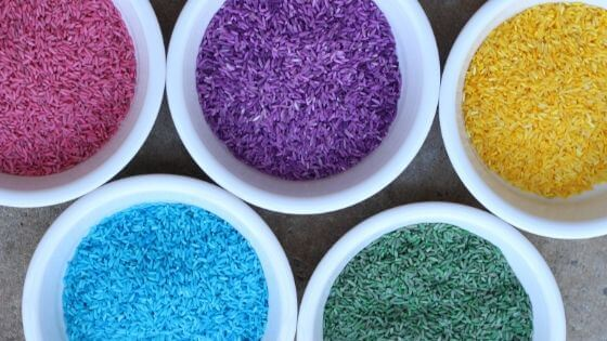 white bowls of colorful rice