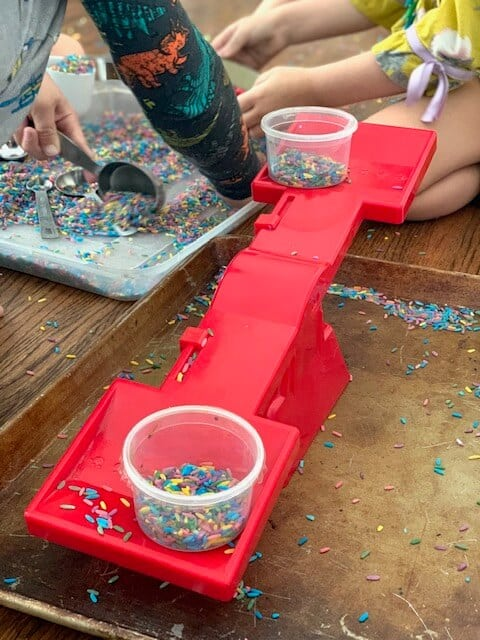 rice sensory bin activity using a scale