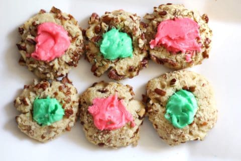 pink and green buttercream thumbprint cookies with nuts