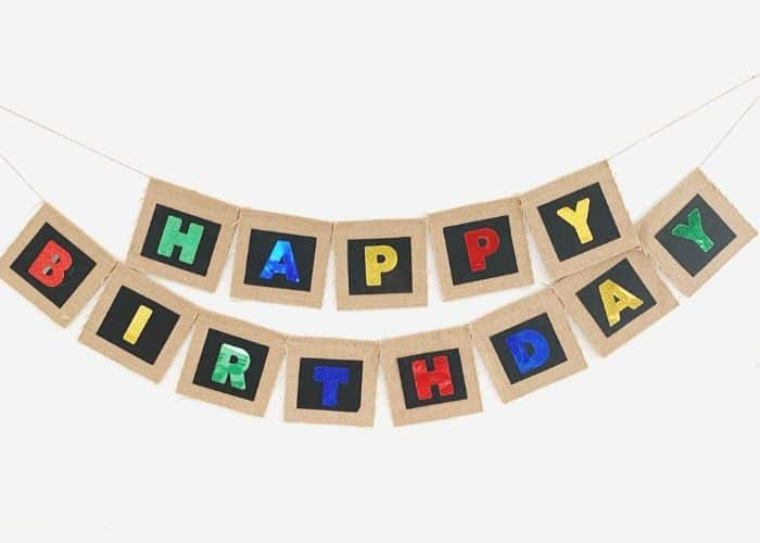 A burlap happy birthday banner hung on the wall