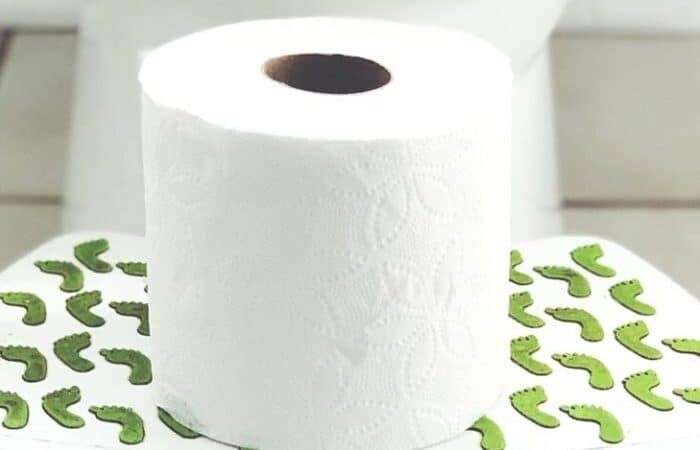 toilet paper on a stool