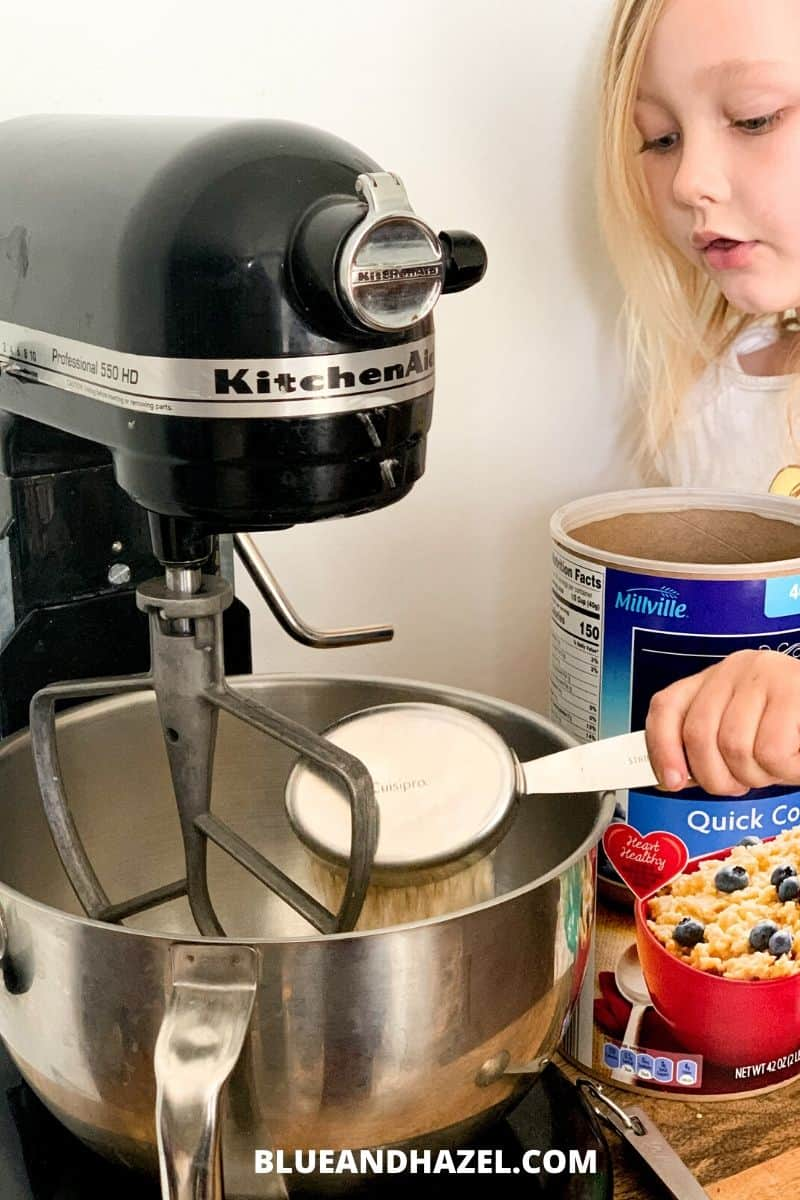 Mixing up peanut butter power balls in a kitchen aid takes 5 minutes and is the perfect kid friendly snack on the go!