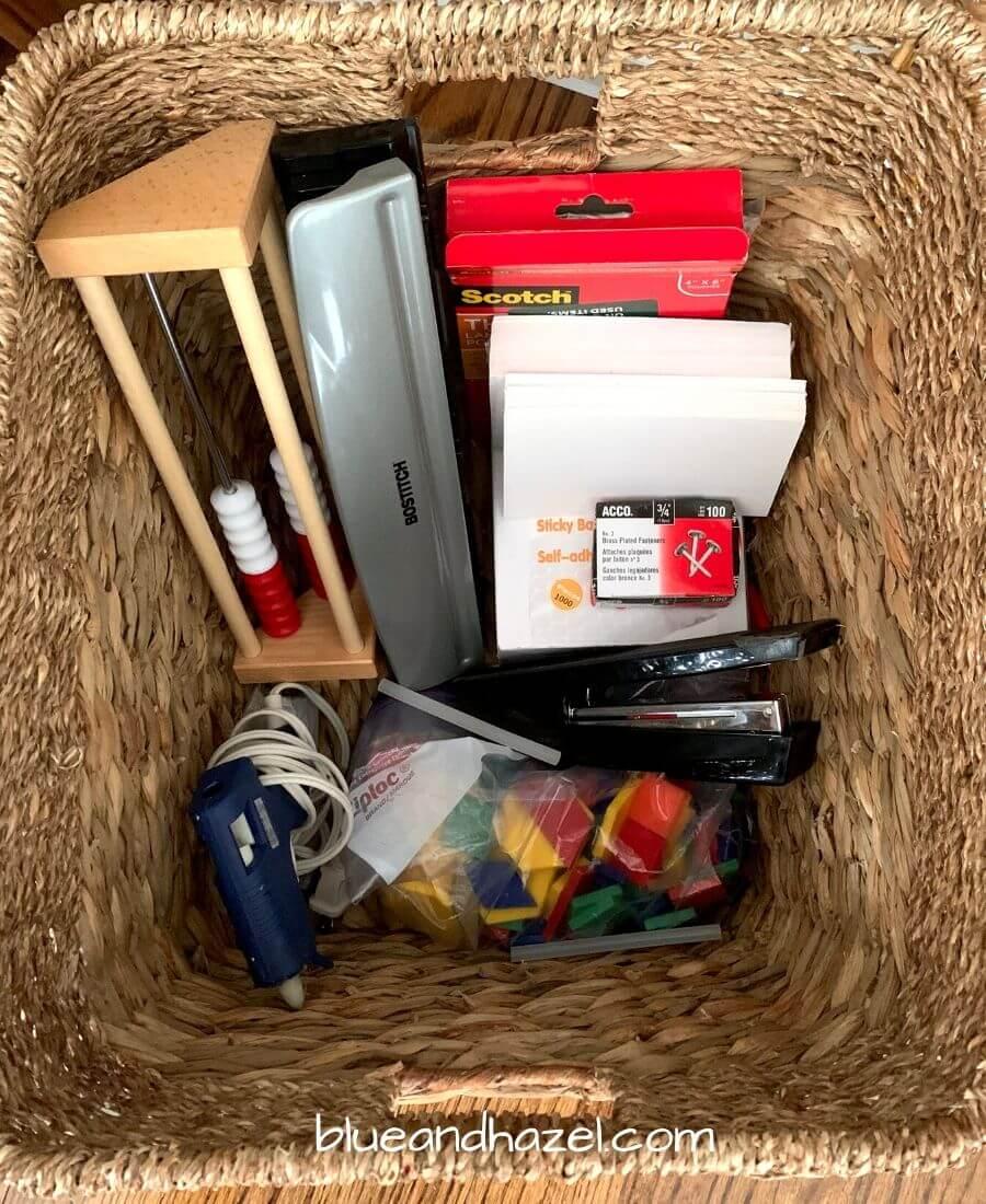 organizing bins holding homeschool supplies