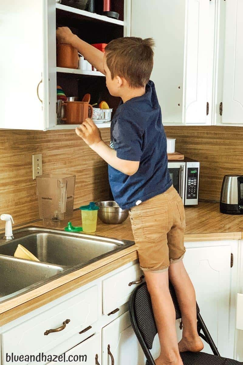 Age appropriate chores for 7 year olds, like unloading the dishwasher and helping in the kitchen.