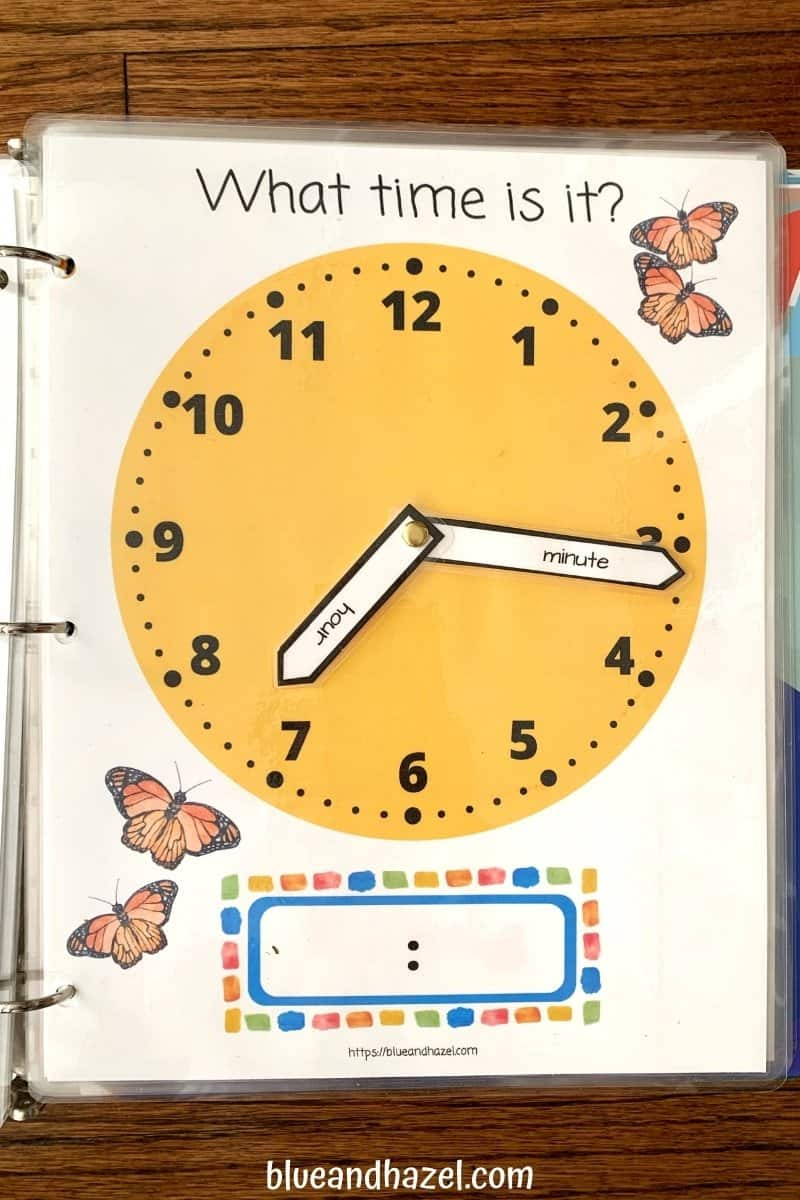 Yellow Printable Math Clock with moveable minute and hour hand, held together by a brad.