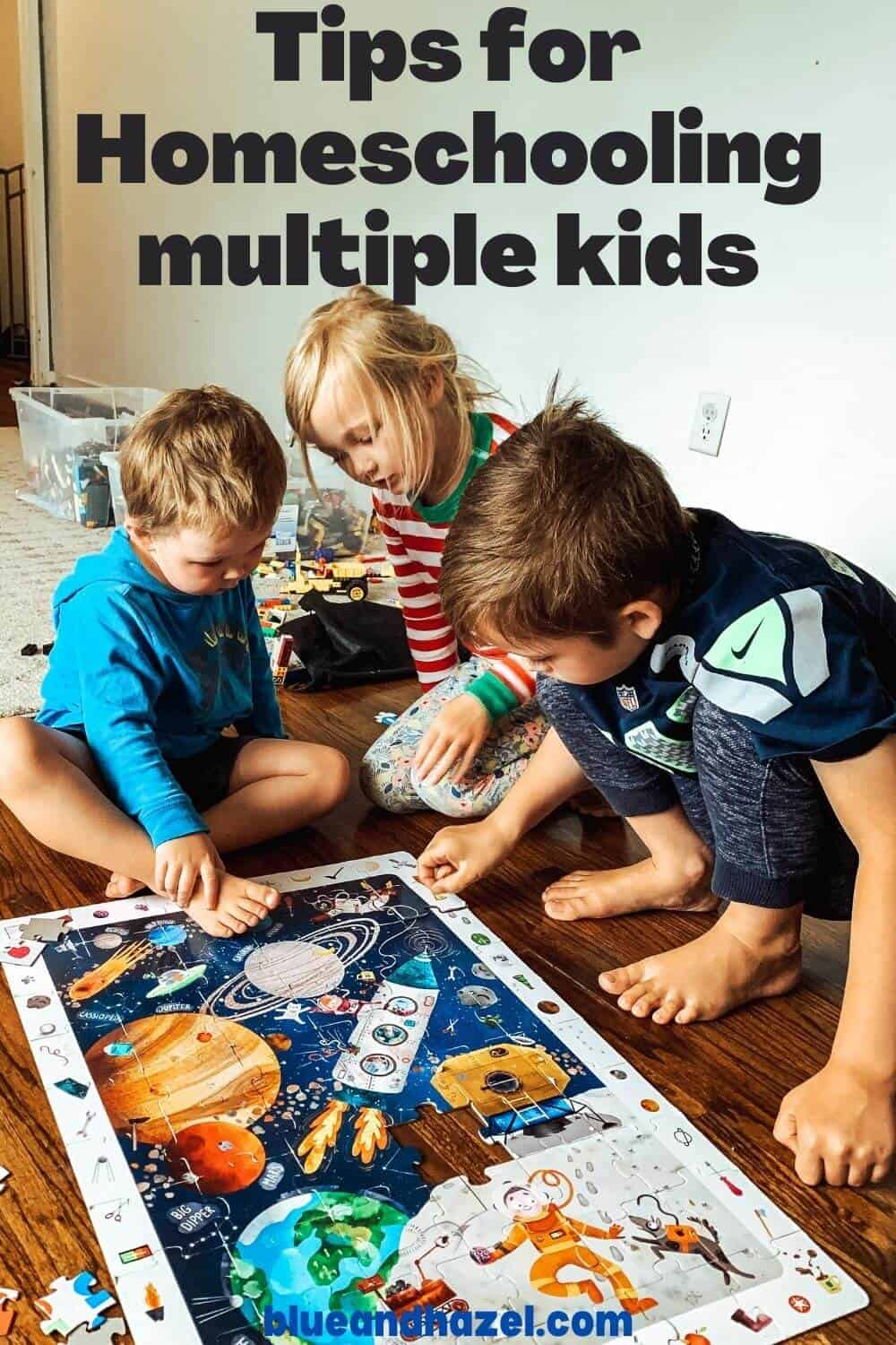 3 kids doing a space puzzle together during a homeschool day