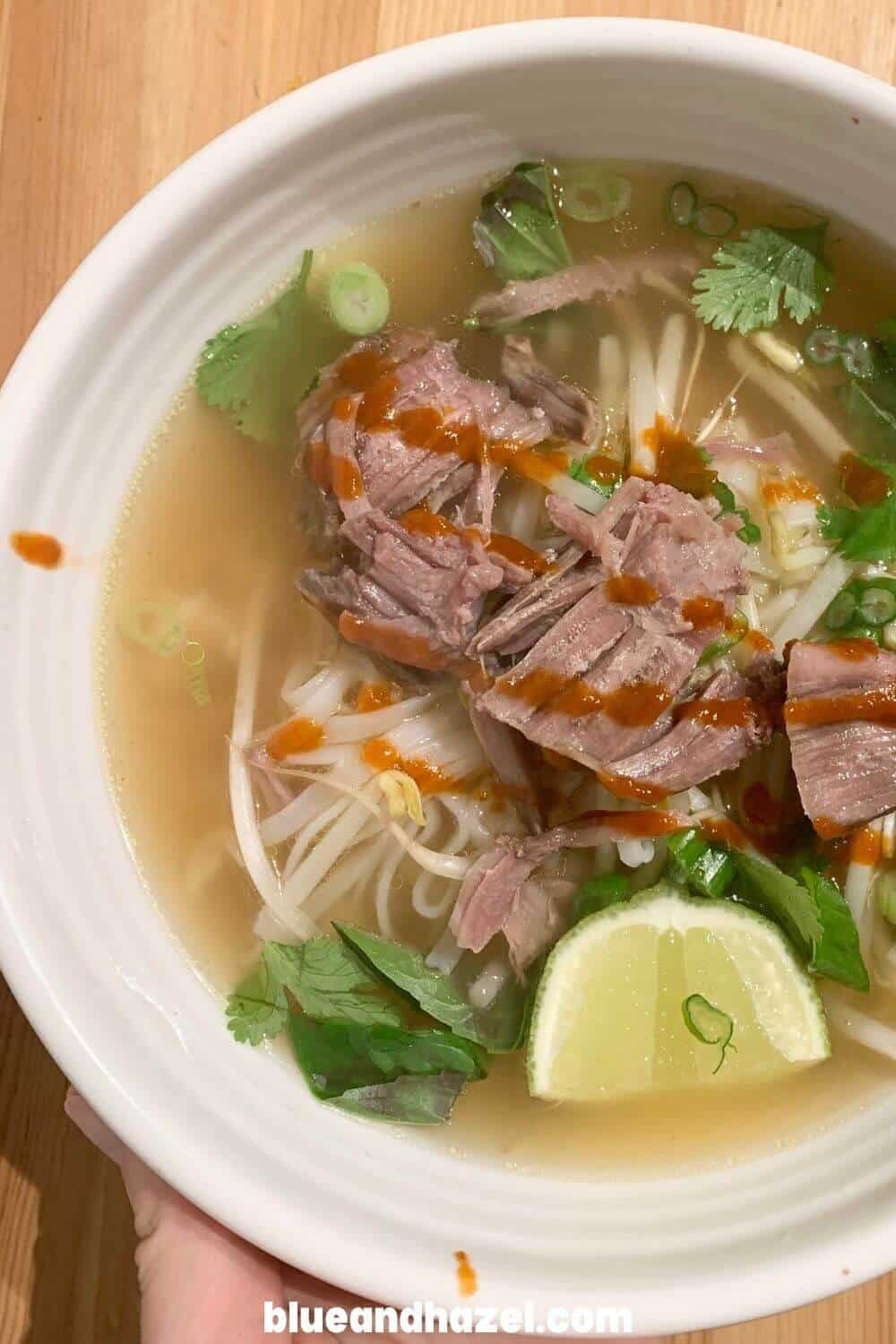 Steaming bowl of homemade beef pho