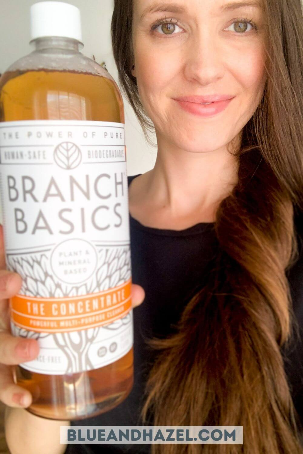 Bottle of Branch Basics Concentrate held by a smiling mom.