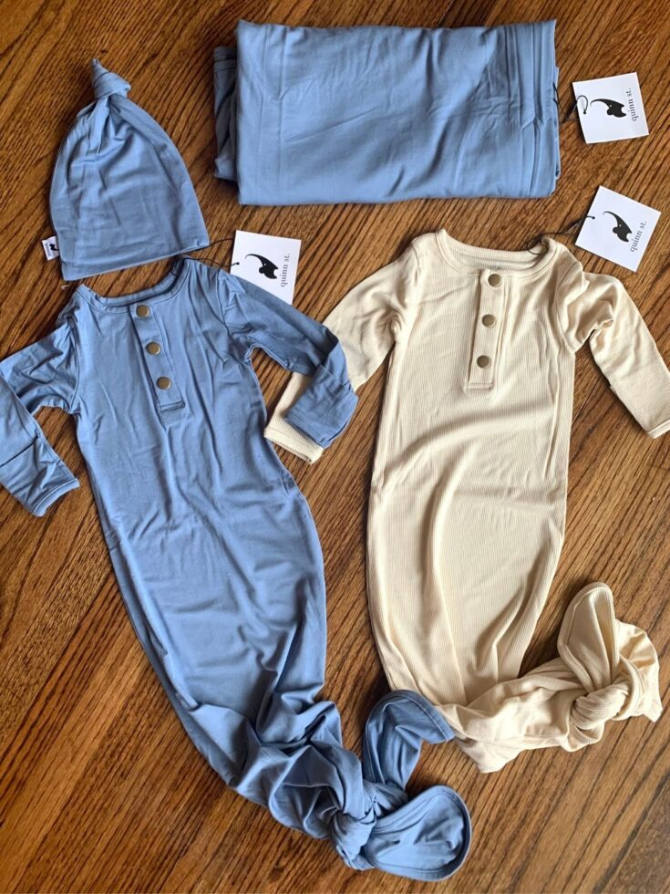 blue and cream newborn onesies with tie bottoms from Quinn St. with hat and matching swaddle.