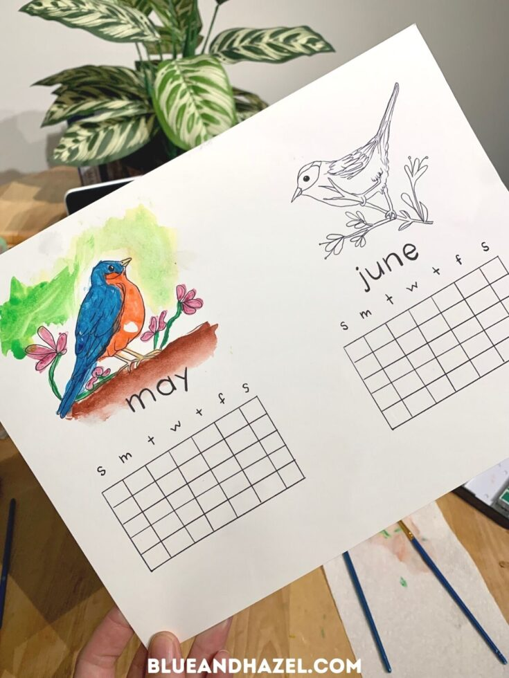 A print out of a calendar with a bird that is painted with watercolor.